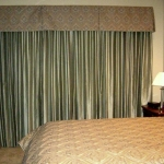 Traversing drapes with queen size custom bedding
