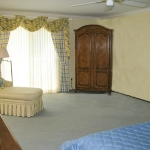 Swags over sheers curtains and chaise lounge
