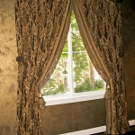 Banded Chenille Curtains on Iron Medallions